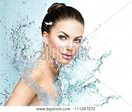 Beautiful Model Spa Woman with splashes of water. Beautiful Smiling girl under splash of water with