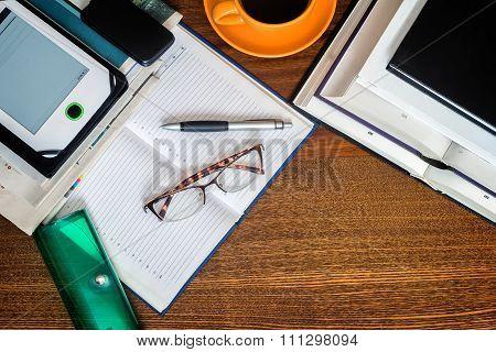 Book, Notebook, Glasses On Your Desktop.