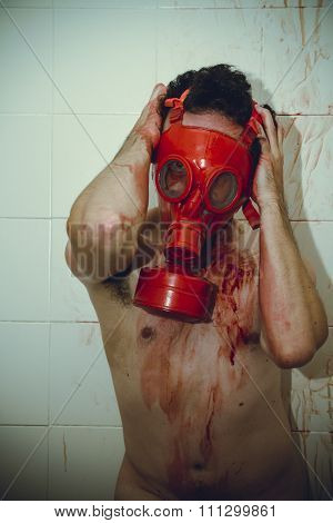 desperation naked man with red gas mask, blood, despair and suicide