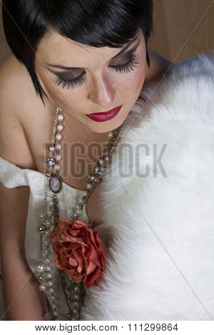 beautiful brunette girl 20s style flapper with jewels and white fur