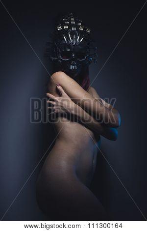 girl alien woman naked helmeted skull and metal forks