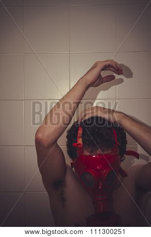 desperate naked man with red gas mask, blood, despair and suicide