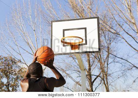 Street basket player playing outdoors