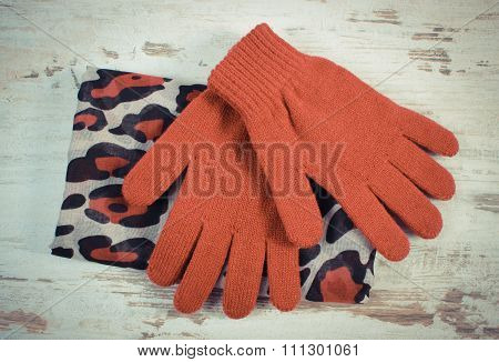 Vintage Photo, Pair Of Woolen Gloves And Shawl For Woman On Old Wooden Background