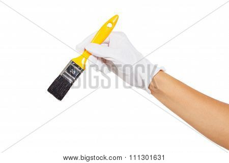 The Hand In White Glove With Yellow Paintbrush