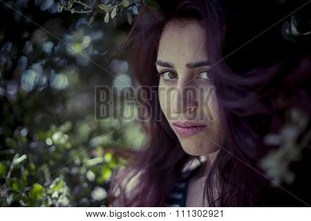 melancholic girl in a forest in autumn, red long hair