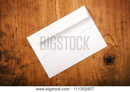 Blank White Mailing Envelope On Office Desk