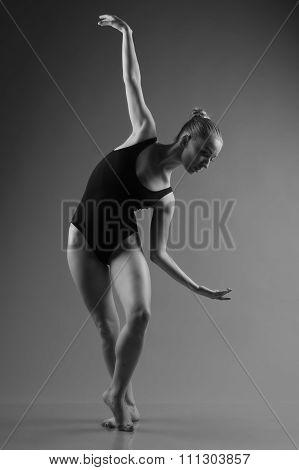 Modern Ballet Dancer Posing On Dark Background
