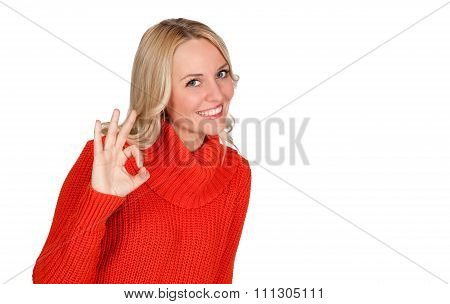 Portrait of smiling young woman showing okay gesture