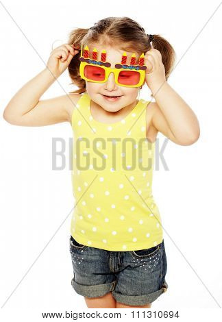happy little girl with fun orange carnaval glasses