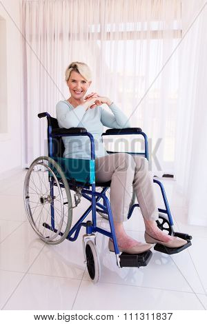 beautiful disabled mid age woman looking at the camera