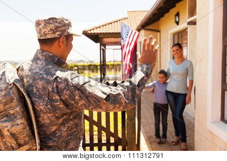 military soldier arriving home with family welcoming him