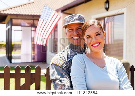 american military couple outside their house