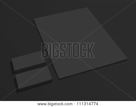 Black branding mockup on dark with business cards.