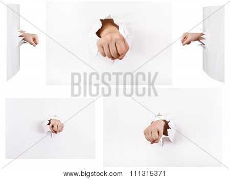 Set Of The Fists Punched A Paper Wall Isolated