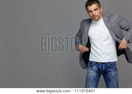 handsome young man in a gray jacket