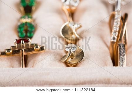 box with jewelery. Rings and pendants.