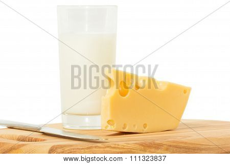 Wedge of cheese, glass of milk