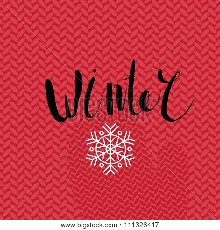 The lettering Winter on the knitted red background