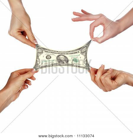 Several hands stretch of banknotes