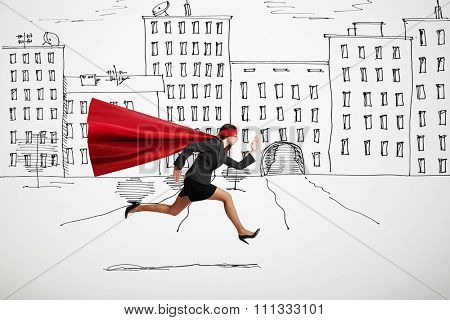 serious businesswoman wearing like superhero very fast running in drawn street