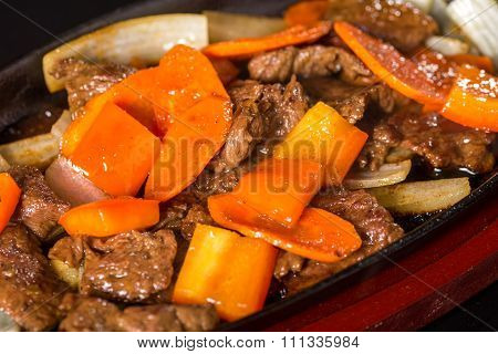 Meat with carrots and onions
