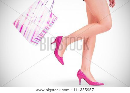 Womans legs in high heels on white background