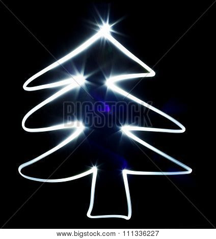 Christmas Tree Made With Blue Flashlight On A Black