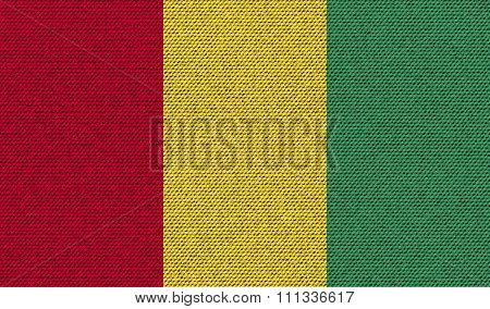 Flags Guinea On Denim Texture.