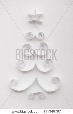 Christmas tree made of paper on white background