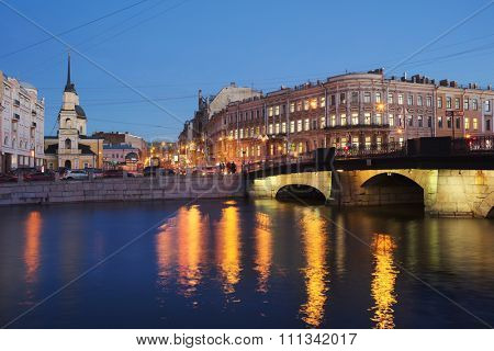 ST. PETERSBURG, RUSSIA - DECEMBER 8, 2015: Belinsky bridge across Fontanka river in evening. Brick bridge was built in 1785 and was named Simeonovsky by nearest church of St. Simeon and St. Anna