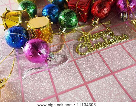 Multicolored Merry Christmas On Pink Tartan Background