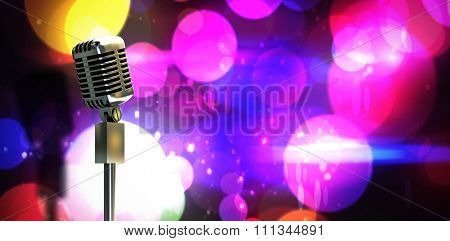 Digitally generated retro microphone on stand against digitally generated cool nightlife design