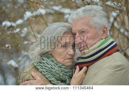 sad senior couple at winter