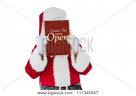 Santa claus presenting card against vintage open sign