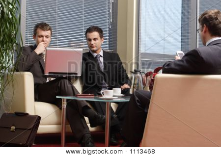 Business Men Working In The Office