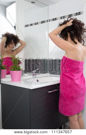 Lovely Middle Age Woman Looking Into A Mirror Her Hair Style