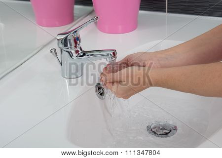 Girl Holding Her Hands In Water Flowing From The Tap, Tilt Up Shot