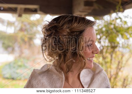 Portrait Of A Cheerful Bride Looking Away