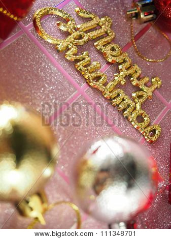 Golden Merry Christmas Tag On Pink Tartan Background