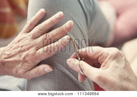 Woman's Hand Cutting Her Fingernails