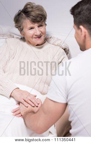 Grandson Visiting Grandmother At Hospital