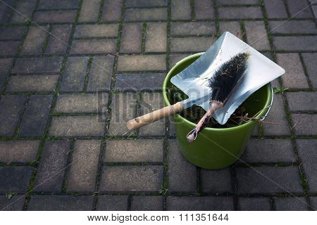 Dustpan, Brush And Bucket Outside On Pavement