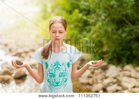 Young Yoga Girl Meditating At Sunrise