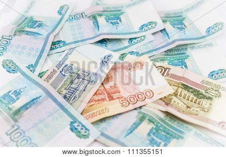 Russian money background. Ruble banknotes of different denominations