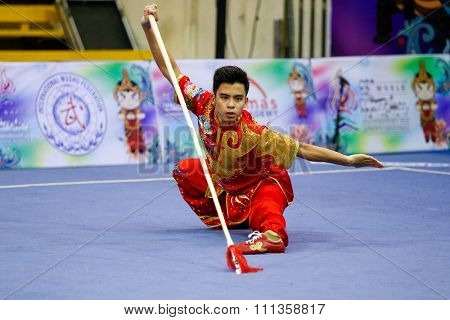 JAKARTA, INDONESIA - NOVEMBER 17, 2015: Jesse Adalia of Singapore performs the movements in the men's Qiangshu event at the 13th World Wushu Championship 2015 at the Istora Senayan Stadium.