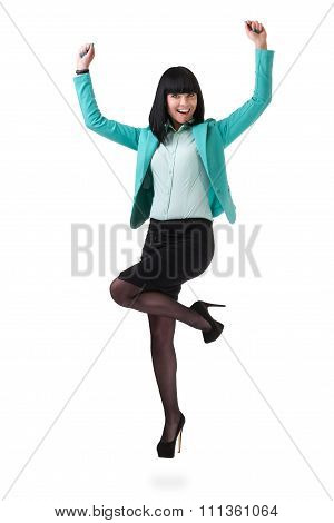 Successful young business woman happy for her success jumping. Isolated full body image on white bac