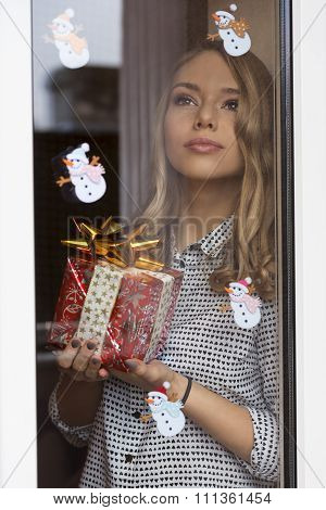 Woman Near Window In Christmas Time