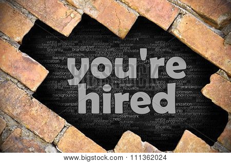 Hole In The Brick Wall With Word You're Hired