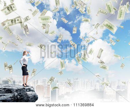 Woman On Cliff Under Money Rain